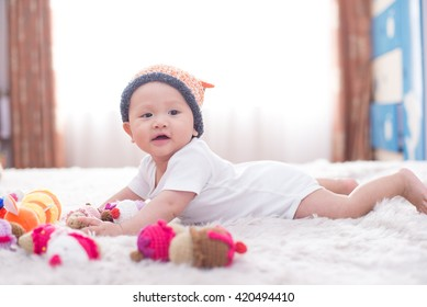 Vietnamese 6 months years old cute boy on the bed