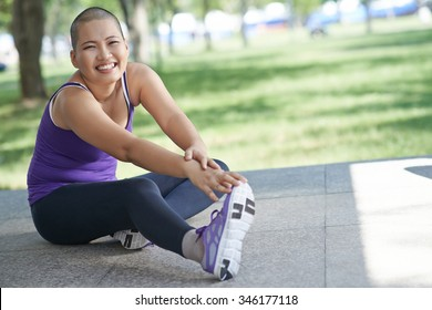 Vietnamese bald woman doing exercising outdoors