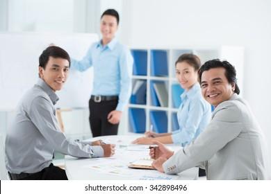 Vietnamese business team having meeting in the office