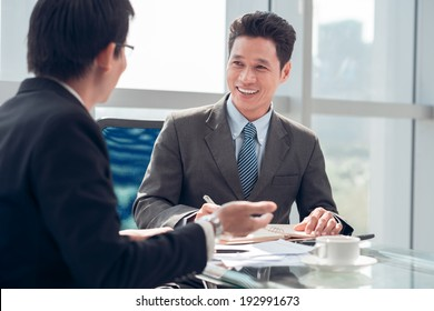 Vietnamese businessman interviewing candidate in the office