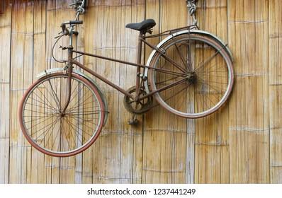 Vietnamese classic bike hanging at bamboo wall, Mai Chau, Vietnam