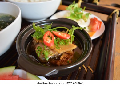 Vietnamese cobia fish cooked with sauce on bamboo tray