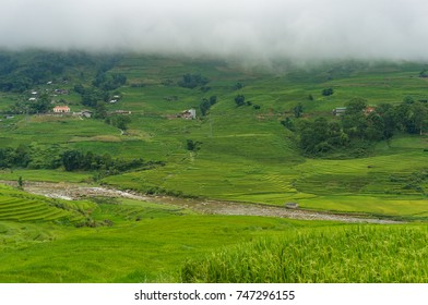 Vietnamese countryside background with green rice terraces and river