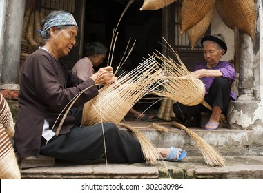 Vietnamese craftsmen making bamboo handicraft products to maintain a traditional handicraft in a countryside of Vietnam. Concept of life in Vietnam