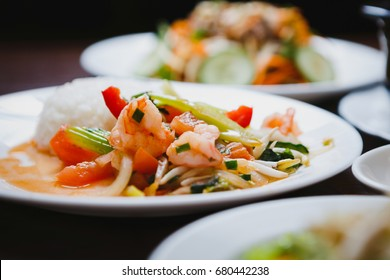 Vietnamese cuisine dish.Colorful salad with celery,boiled shrimps & fresh vegetables served on white plate in restaurant.Exotic cuisine cafe menu item