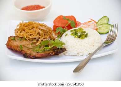 Vietnamese Cuisine - Grilled Pork Chop and Rice with Spicy Fish Sauce (Com Tam Suong Bi)