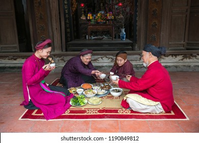 Vietnamese family having Tat Nien meal, the penultimate New Years Eve, the meal finishing the entire year, on family reunion day, during Lunar New Year holiday called Tet