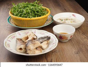 Vietnamese fish congee (Chao ca). It is famous in Southern Vietnam where river fish is diverse and a source of eating. Catfish is slow cooked and eaten with bitter herbs. It is good to keep fever away