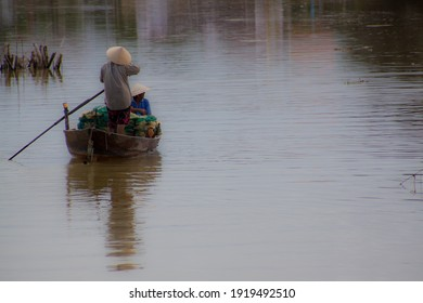 Vietnamese fisher woman on river