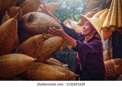 Vietnamese fishermen are doing basketry for fishing equipment at morning in Thu Sy Village, Vietnam.