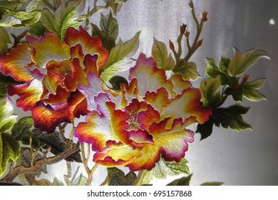 Vietnamese flower silk embroidery as a main theme of the traditional Vietnamese embroidery pictures