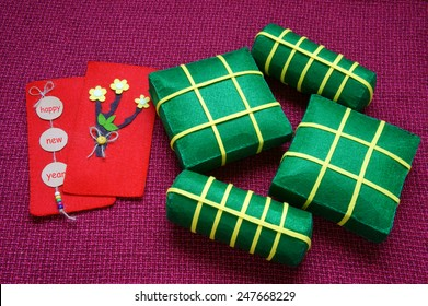 Vietnamese food,  banh chung, banh tet are traditional eating on Tet holiday, wrap in green leaf. When spring come, on Vietnam Lunar New Year , people worship the ancestor with glutinous rice cake