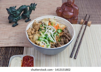 Vietnamese food: Bo Bun chicken with beef, served with asian decoration.