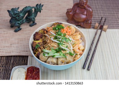 Vietnamese food: Bo Bun shrimp with chicken, served with asian decoration.