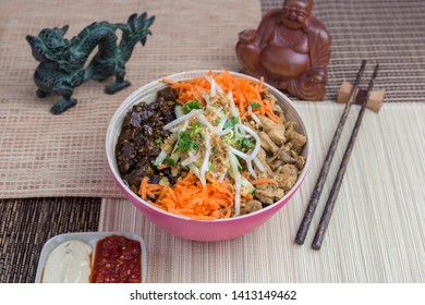 Vietnamese food: Bo Bun Tofu with chicken and carrots, served with asian decoration.
