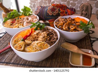 Vietnamese food: Bo Bun Vegetarian, Bo Bun Beef, Bo Buan Chicken, served with asian decoration and Vietnamese Buffalo symbol.