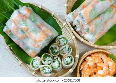 Vietnamese food, goi cuon is street food, roll that delicious, wrapped from shrimp, pork, vegetables, bun in rice paper, with accompaniments:  sauce, chili,  another name: salad roll, soft roll..