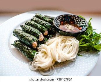 Vietnamese food, Grilled Pork Wrapped in Wild Betel Leaf served with rice noodles and sweet sauce, healthy food. (Thit Bo Nuong La Lot), Beef and lemongrass wrapped in betel leaf.