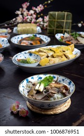 Vietnamese food for Tet holiday in spring, it is traditional food on lunar new year:  soya noodles soup, boiled chicken,  fried vegetable, jellied meat, chung cake