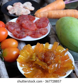 Vietnamese food for Tet holiday in spring, mango jam, sweet eating is traditional food on lunar new year, can make from mango fruit cook with sugar,  amazing background for Vietnam culture