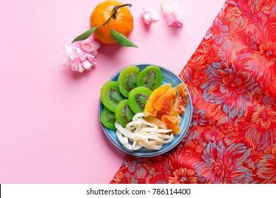 Vietnamese food for Tet holiday in spring, it is traditional food on lunar new year: dried candied fruit kiwi, coconut, papaya