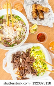 Vietnamese food, traditional soup Pho, strong broth, beef and rice noodles, Bun bo Nam Bo and fried spring rolls