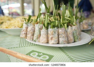 Vietnamese fresh and vegetarian spring roll (Goi cuon chay). Julienned jicama and carrot are steamed, and mixed with fried tofu. They are wrapped into rice paper and vegetable then eat with soy sauce.