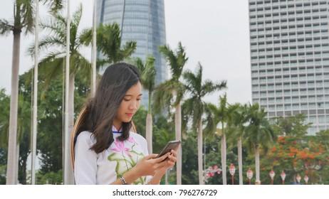 Vietnamese girl talking on the phone. Danang city
