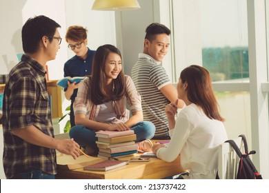Vietnamese high school students in classroom talking during the break