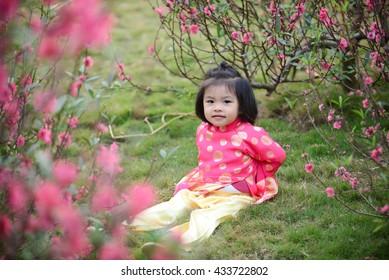 Vietnamese kid play in garden in spring