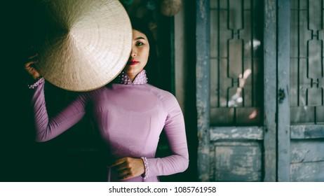 Vietnamese lady with Ao Dai Vietnam traditional dress, Vietnam