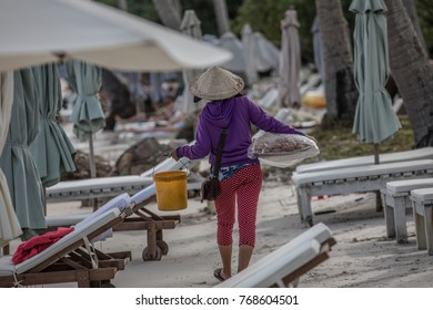 Vietnamese lady selling goods on the beach