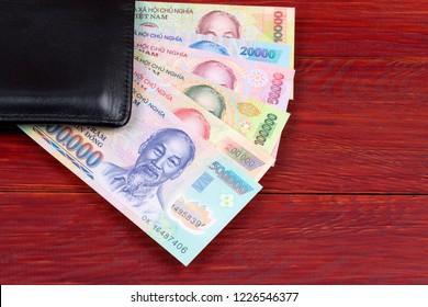 Vietnamese money in the black wallet