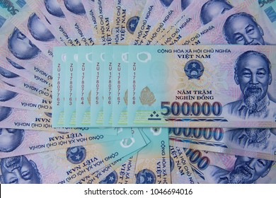 Vietnamese money dong on white table. Just printed asian money. Asian money fan out. Concept of rich and sucsess. 500000 vnd
