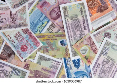 Vietnamese money dong (VND) on white background. Just printed new bills. Chaotic mix of different money nominations. Asian currency background for business, finance and economical issues. Money photo