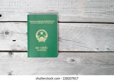Vietnamese passport against wooden background