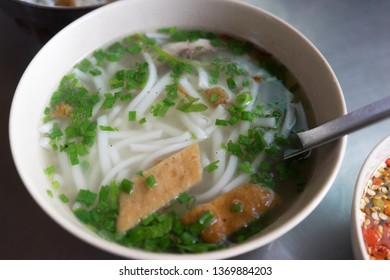 Vietnamese Phan Rang fish noodles: Broth made from fresh fish in Phan Rang, then vermicelli noodles (bigger shape) is added with the soup, topped with fried fish and cooked fish flesh, chopped shallot