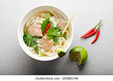 Vietnamese pho bo soup on a beaf broth above view