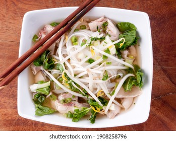 Vietnamese pho soup with chicken, broth, bean sprouts, noodles, and basil