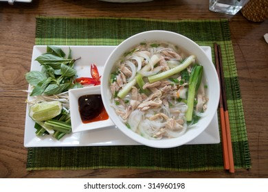 Vietnamese pho soup, an ethnic meal of chicken soup, broth, bean sprouts, noodles and basil or cilantro floating on top.