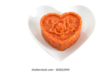 Vietnamese red glutinous sticky rice, xoi gac forming heart shape