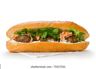 Vietnamese sandwich, or Ban Mi on  a white background.