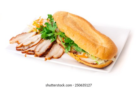 Vietnamese sandwich banh mi. Sandwich prepared with slices of bacon, baguette and fresh vegetables: cucumber, carrots, parsley and tomato. Asian food, cuisine. Restaurant, menu, snack, lunch time