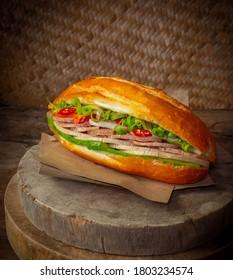 Vietnamese sandwich -Vietnamese Banh Mi in wood backgruond