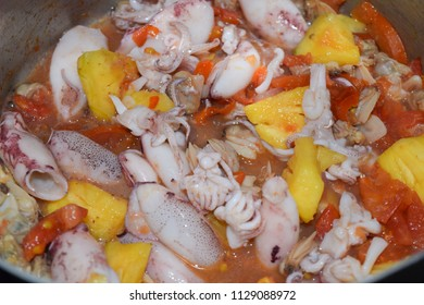vietnamese seafood salad with cutter, tomato and pineapple sauce