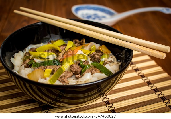 Vietnamese soup pho bo with asian noodles and beef meat
