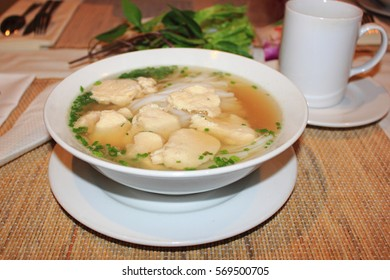 Vietnamese soup Pho with chicken and noodles in the white plate, Vietnamese cuisine