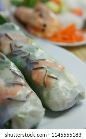 Vietnamese Spring Rolls with mealworms, shrimp, rice paper, vermicelli noodles, pork, carrots, and cucumber.