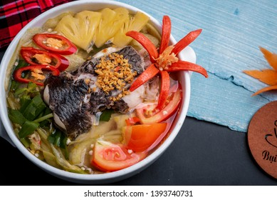 Vietnamese traditional food: sour fish soup:  made with snakehead fish