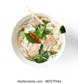 Vietnamese traditional noodle pho soup made of  broth, herbs, meat and rice noodles. It is a popular street food in Vietnam being served at any time of the day, starting from breakfast. Overhead shot